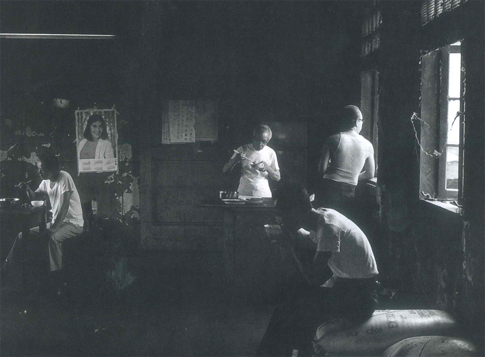 Photo by Paul Calhoun of Chinese laundry workers in Chinatown on lunch break in the 1980s