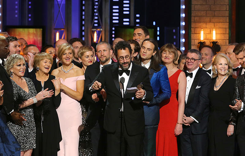 "Playwright Tony Kushner, center, and the cast and crew of ""Angels in America"" accept the award for best revival of a play at the 72nd annual Tony Awards at Radio City Music Hall on Sunday, June 10, 2018, in New York. (Photo by Michael Zorn/Invision/AP)"