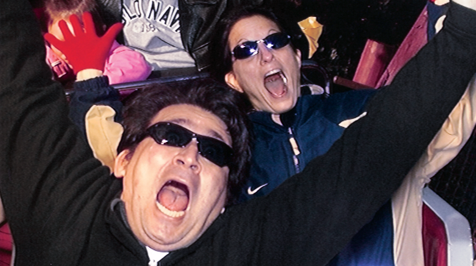 Photo of Martin and Cheryl Lewison on a roller coaster