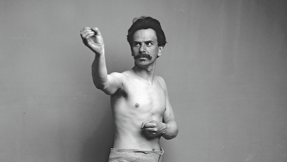 Archive photo of Franz Boas reenacting a Kwakiutl ceremonial dance to assist Smithsonian Institution sculptors building a diorama