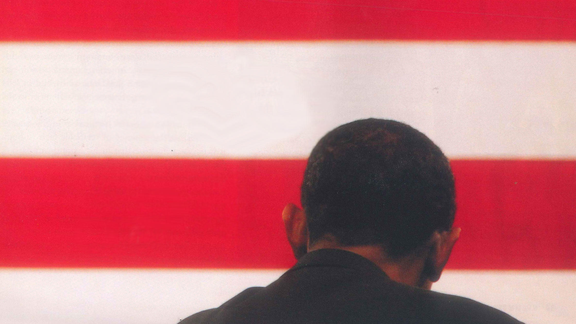 Photograph of the back of Barack Obama's head over American flag stripes
