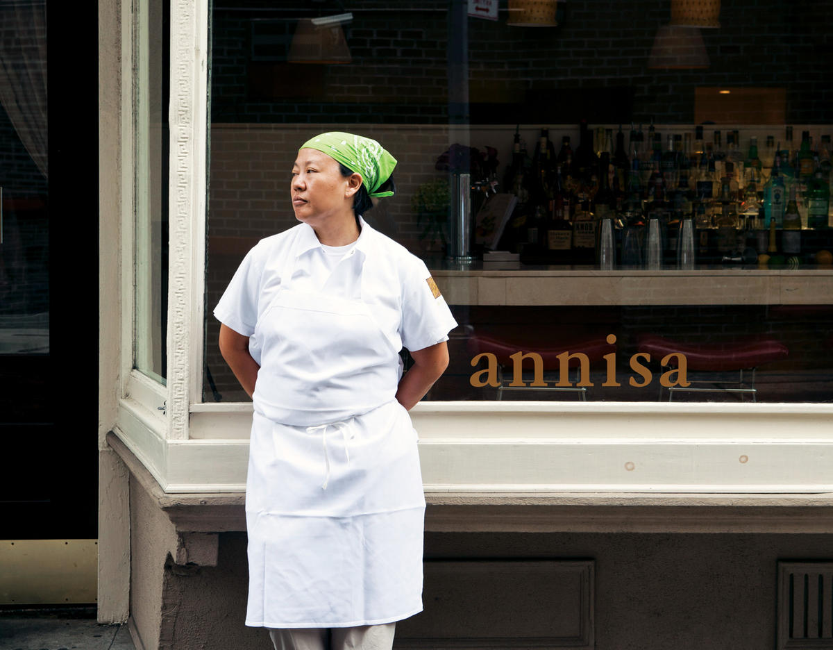 Anita Lo in front of Annisa restaurant