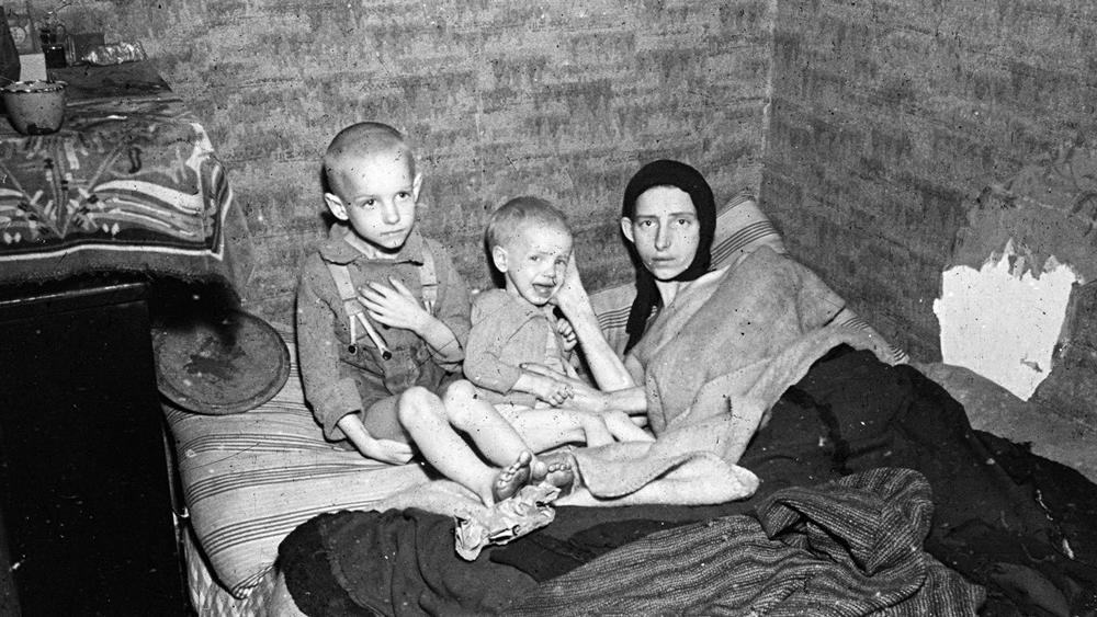 A mother and two children during the Dutch famine of 1944