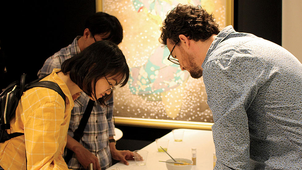 Students at Columbia's Center for Science and Society mix pigments at the Sato Sakura Gallery