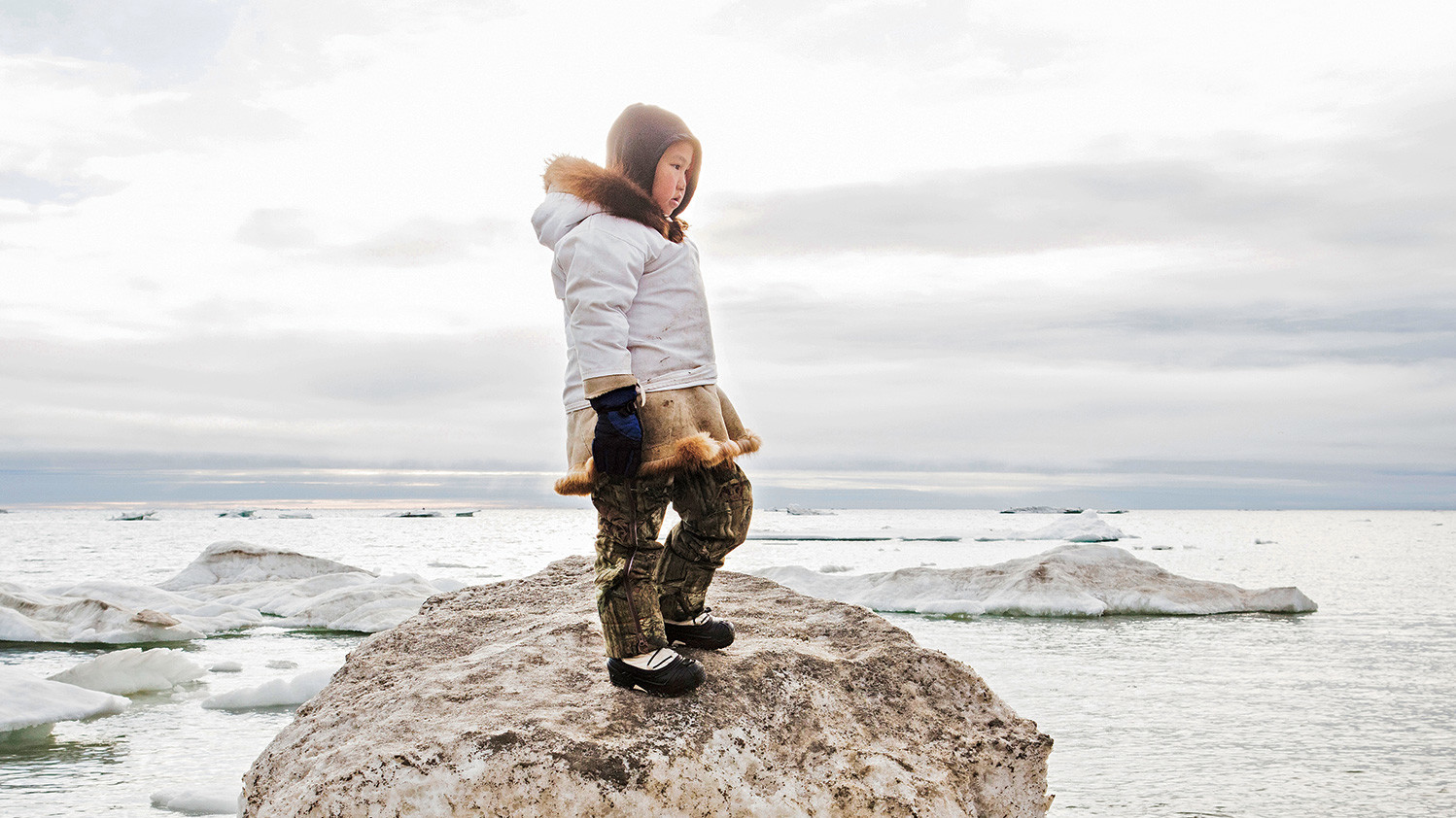 Photo of an Inuit child by Katie Orlinsky
