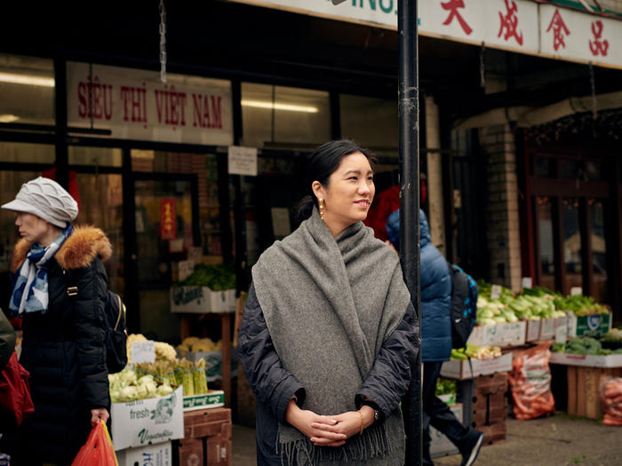 MOLD magazine founder LinYee Yuan in front of a food market