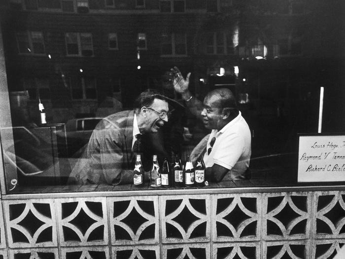 Photograph of two men in a bar by Jack Eisenberg