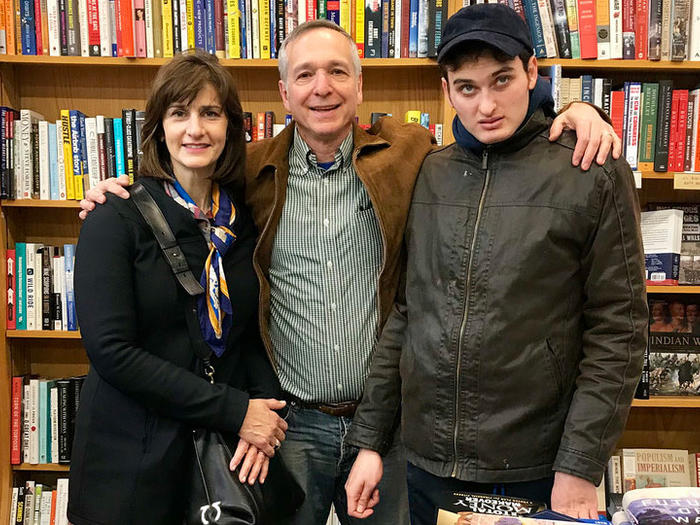 Jonah Zimiles, owner of Words bookstore, with his wife and son