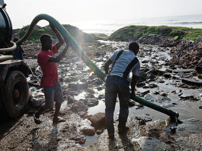 Sewage treatment technicians in Accra, Ghana