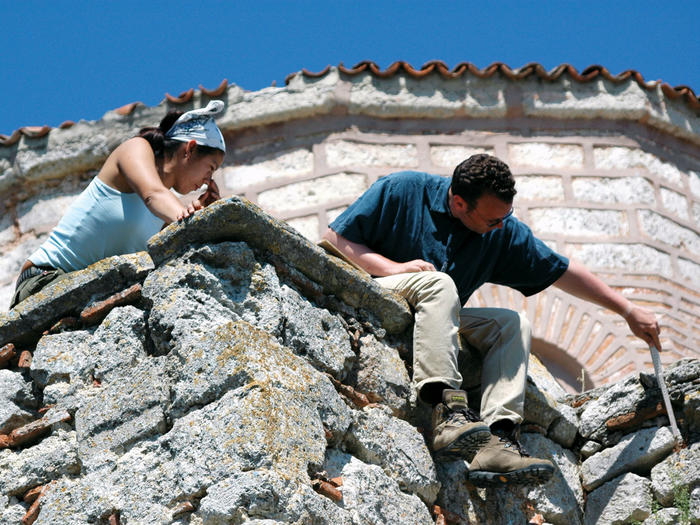 Art historian Holger Klein measures part of a Byzantine-era church during an archeological survey in Vize, Turkey