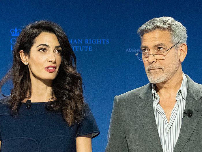 Amal and George Clooney speaking at Columbia Law School