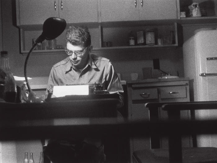 Photo of Allen Ginsberg at typewriter