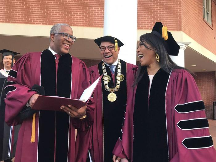 Robert F. Smith, left, laughs with David Thomas, center, and actress Angela Bassett at Morehouse College, May 19, 2019, in Atlanta.