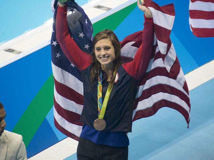 Kate Melli with American flag at Olympics