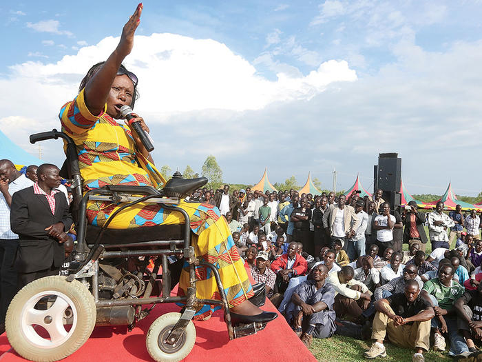 Dennitah Ghati, a disability advocate in Kenya, speaking at an event in Kenya