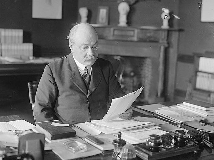Nicholas Murray Butler photographed at desk in 1916 (Library of Congress)