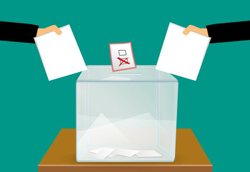 Illustration of ballots and ballot box