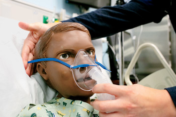 A patient simulation robot with a breathing mask at the Columbia University School of Nursing