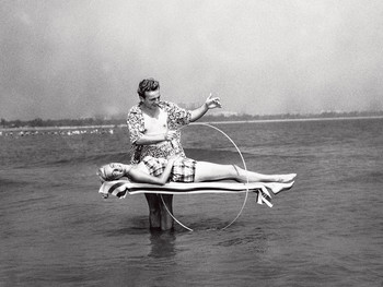 Black and white photo of a magician practicing levitation in Lake Michigan during the summer of 1955