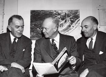 Dwight Eisenhower reading Columbia Alumni News in 1949 with James Kip Finch and Felix E. Wormser