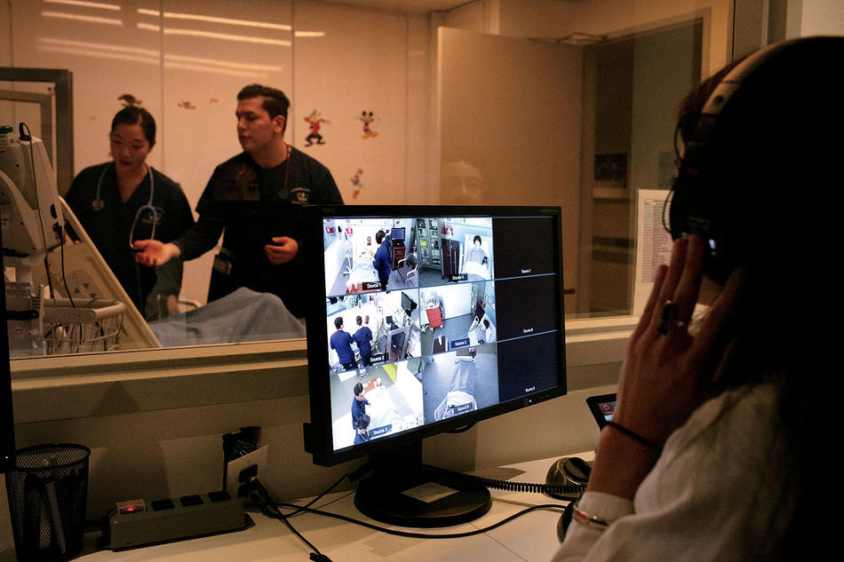At Columbia Nursing School's patient simulation center, Nursing professor Kellie Bryant observes the students from behind a one-way mirror.