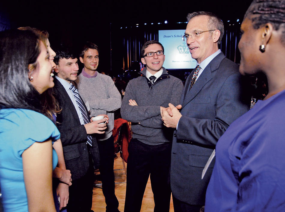 James J. Valentini chatting with students at the Dean's Scholarship Reception in February 2012