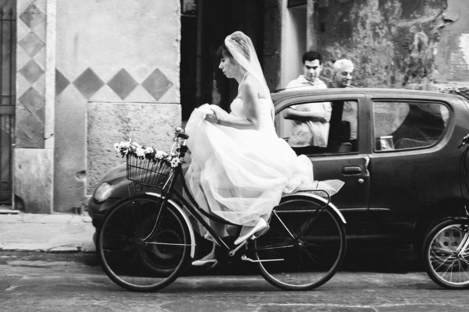 "Black and white photo of bride riding bicycle: ""Bridecycle"" by Pan Su ""Peter"" Kim"