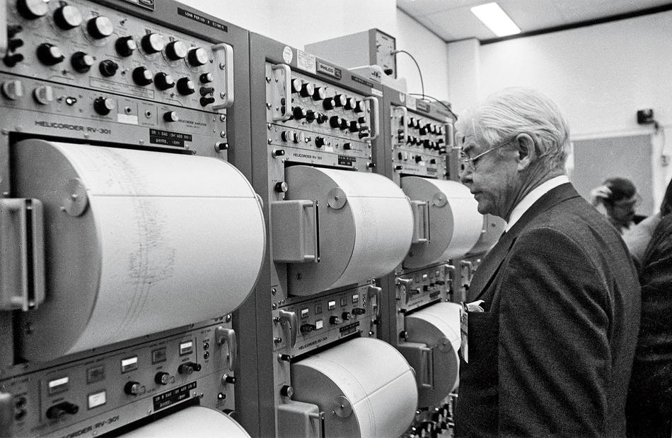 Maurice Ewing examines seismographic readings from the impact of a Saturn S-IVB rocket on the moon. (NASA)