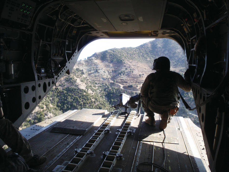 The view from the back of a CH-47 as American and Afghan soldiers descend into the Kunar River Valley along the Afghan-Pakistani border. (Jason Dempsey)