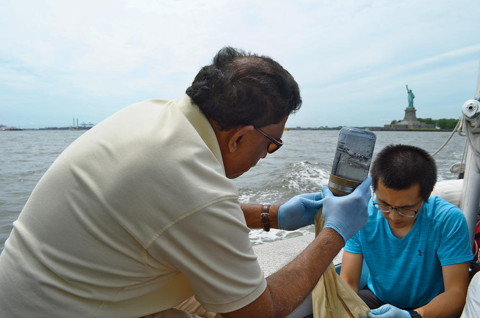 Columbia Lamont Doherty Earth Observatory's Joaquim Goes and visiting scholar Ye Li filtering water in New York Harbor