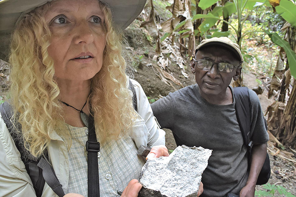 Cornelia Class and archaeologist Bourhane Abderemane inspecting a chunk of quartzite on Anjouan