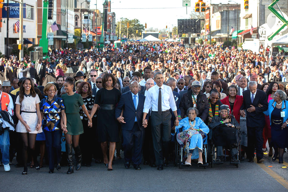 The Obama family with Georgia congressman John Lewis in a walk across the Edmund Pettus Bridge in Selma, Alabama, on March 7, 2015.