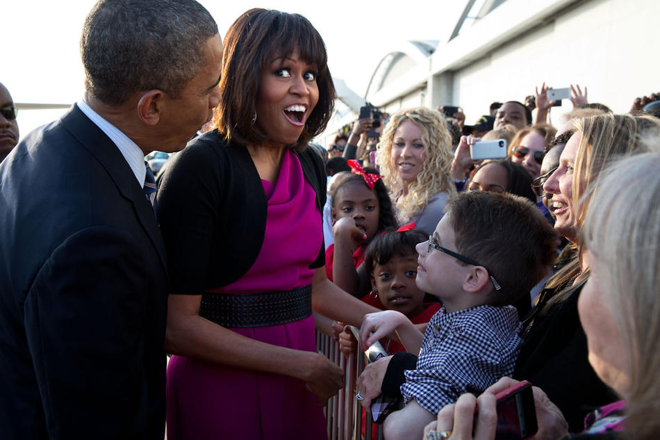 Barack and Michelle Obama meeting crowd
