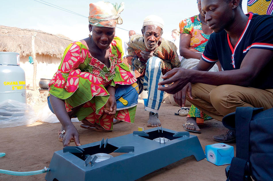 People in Ghana installing a low-emissions stove