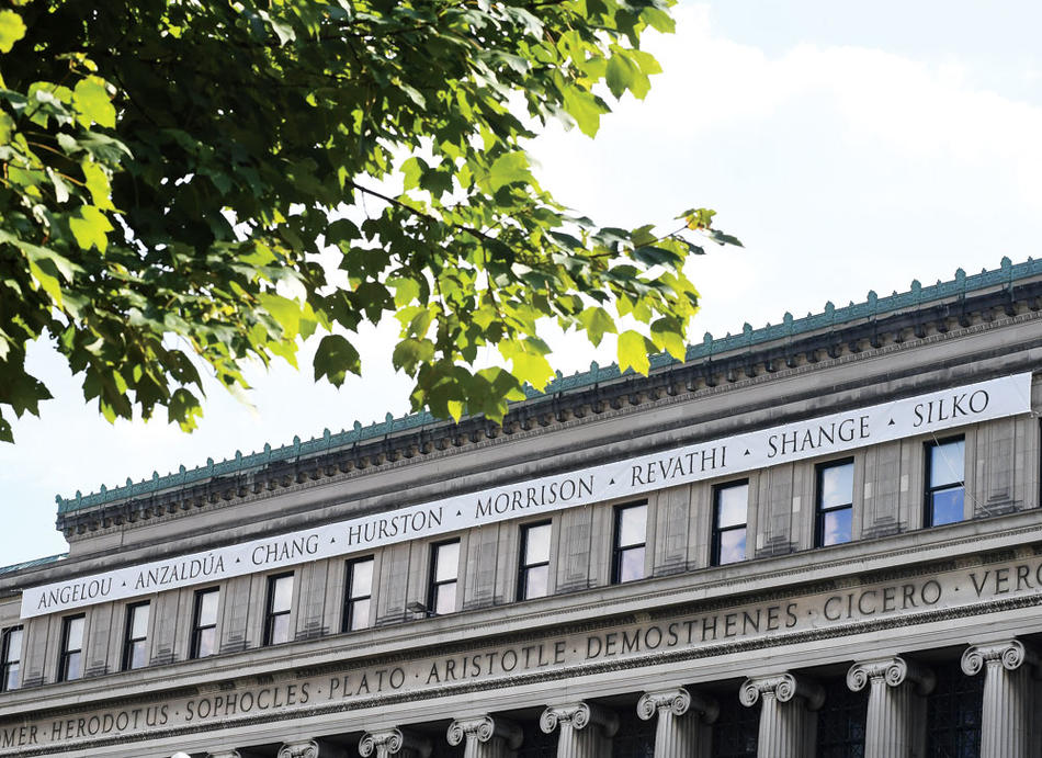 Women writers' names on Columbia Butler Library, over names of male writers
