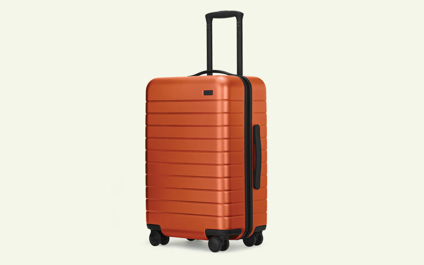 Orange carry-on suitcase from Away