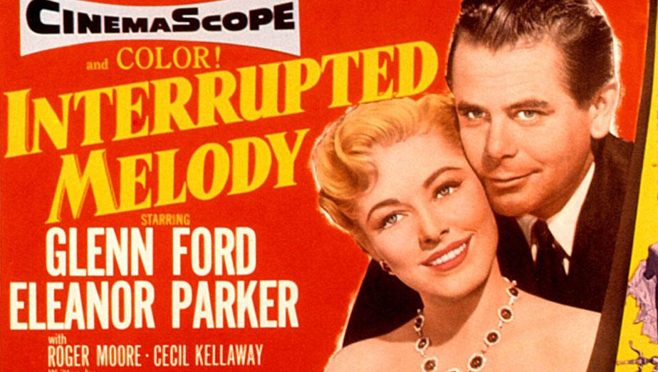 Lobby card for 1955 film Interrupted Melody