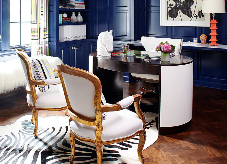 A desk and chairs in a room painted blue