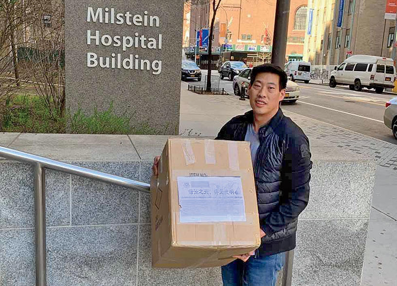 Thomas Lo '08PS, director of the Columbia Vagelos College of Physicians and Surgeons Alumni Board, delivering a box of PPE to Columbia Medical Center