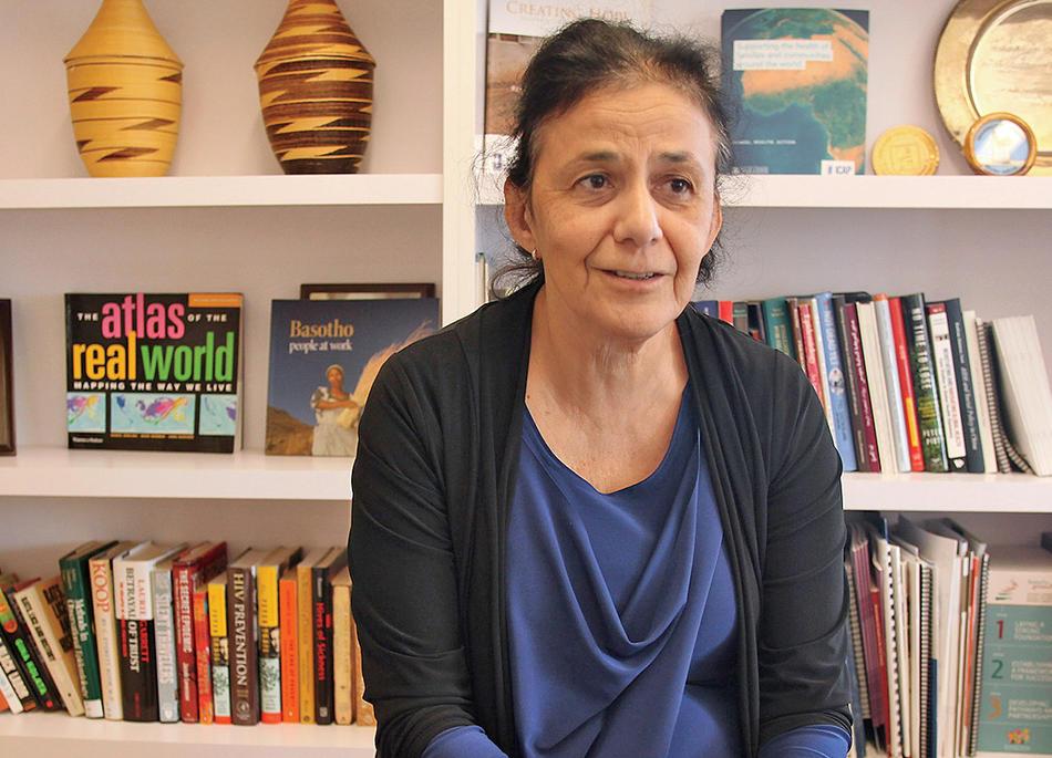 Columbia epidemiologist Wafaa El-Sadr in front of bookshelf