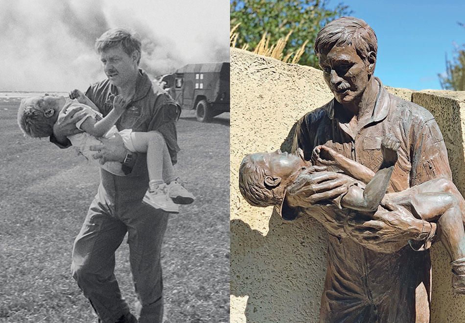 Photo of Spencer Bailey being carried to safety after a 1989 plane crash next to a bronze sculpture memorializing the event